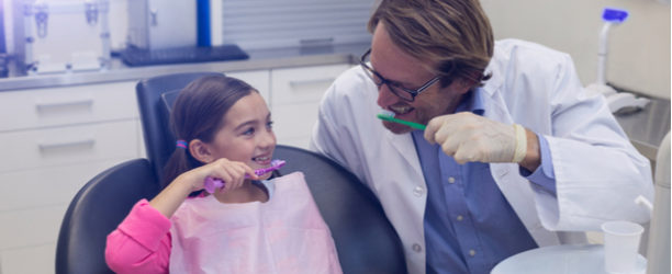 child visiting a pediatric dentist