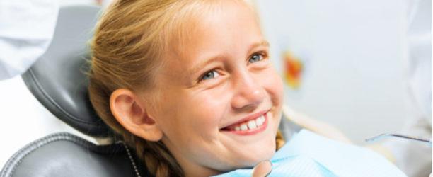 girl smiling in dental chair